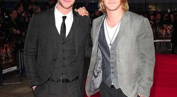 Chris Hemsworth says sibling rivalry with his brothers Liam (pictured) and Luke does not extend to their acting