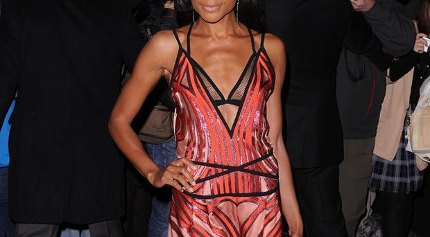 Naomie Harris, who portrays Winnie Mandela in a Nelson Mandela biopic, took the best British actress title at the Harper's Bazaar Women of the Year Awards