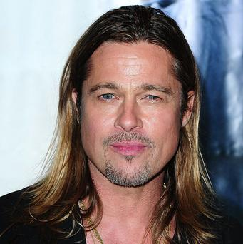 Producers of Brad Pitt's new movie allegedly filmed Nazi war scenes in an English village on Remembrance Day