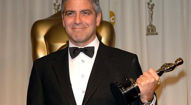 George Clooney says he doesn't understand why famous people use Twitter