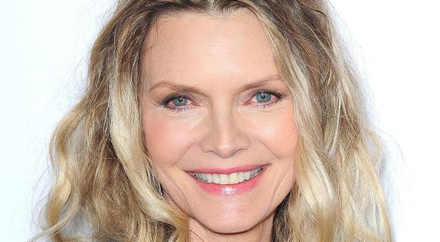 Michelle Pfeiffer stars in The Family