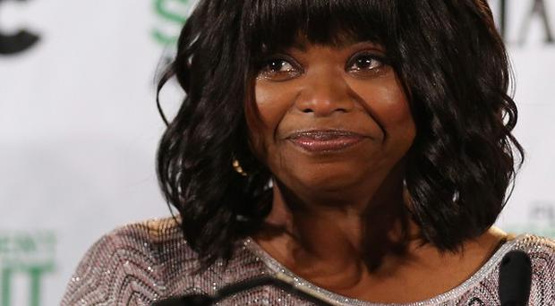 Octavia Spencer reacts as Fruitvale Station receives a nomination at the Film Independent Spirit Awards press conference (AP)