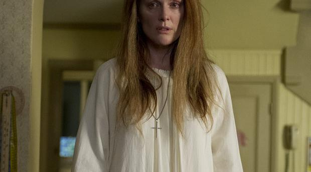 Julianne Moore plays troubled mother Margaret White in Carrie