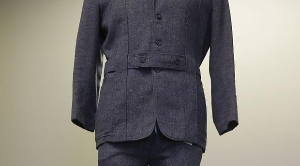 The grey wool suit Gene Kelly wore in the movie Singin' in the Rain is displayed at Heritage Auctions in Dallas (AP)