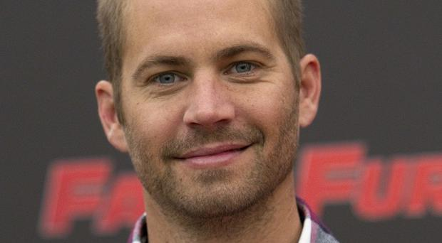Paul Walker starred in the Fast & Furious franchise (AP/Andrew Medichini)