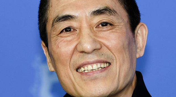 Chinese director Zhang Yimou has admitted flouting his country's strict family planning rules