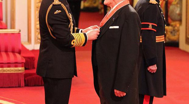 Julian Glover is made a CBE by the Prince of Wales at an investiture ceremony at Buckingham Palace