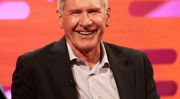 Harrison Ford has said he would like to play Indiana Jones again
