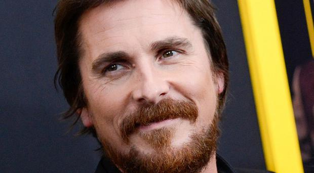 Christian Bale plays a con artist in American Hustle