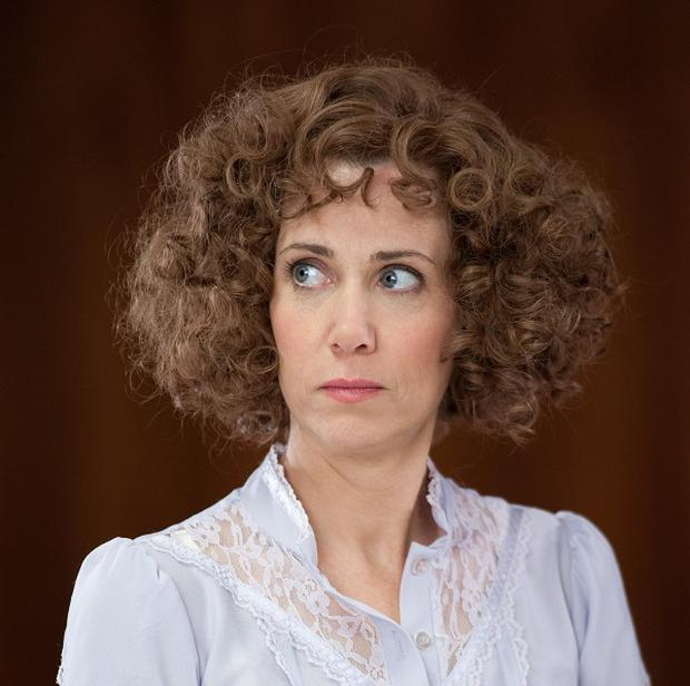 Kristen Wiig rocks a curly wig in Anchorman 2: The Legend Continues