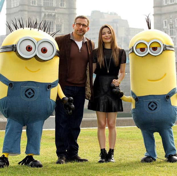 Steve Carell and Miranda Cosgrove with the minions from their movie Despicable Me 2