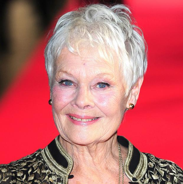 Dame Judi Dench admits she will miss James Bond