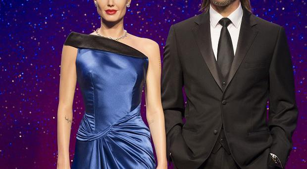 Brad Pitt and Angelina Jolie's waxworks have been given a makeover to mark Brad's 50th birthday