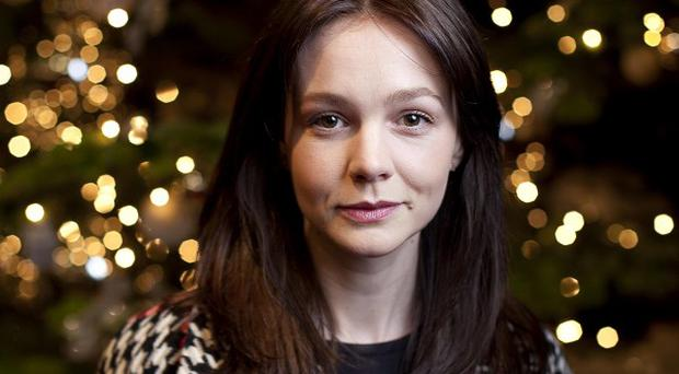 Carey Mulligan has said she swore a lot in her Inside Llewyn Davis role