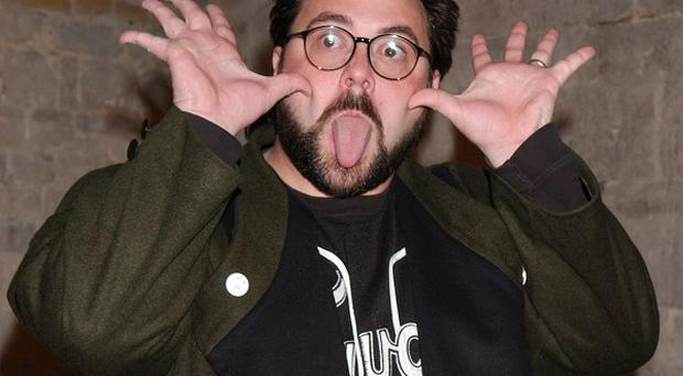 Kevin Smith says he is writing a musical about a giant Jesus