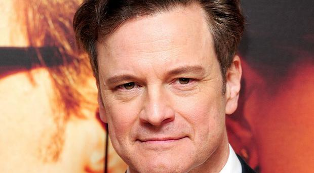 Colin Firth loves to cuddle his guitar