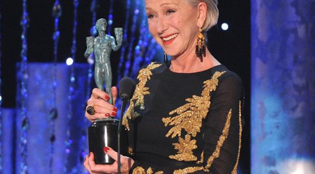 Dame Helen Mirren accepts the award for outstanding performance by a female actor in a television movie or mini-series at the Screen Actors Guild Awards in Los Angeles (Invision/AP)