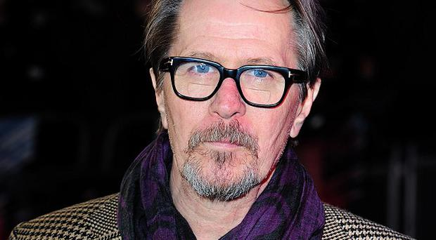 Gary Oldman arrives at the premiere of Robocop at the BFI IMAX in London