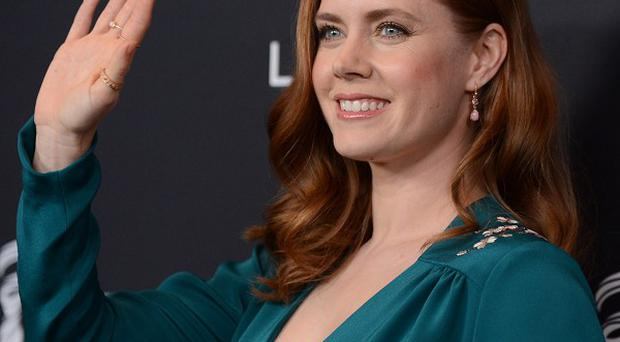 Amy Adams was presented with the Lacoste Spotlight Award