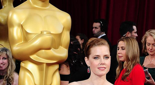 Amy Adams arriving at the 86th Academy Awards.
