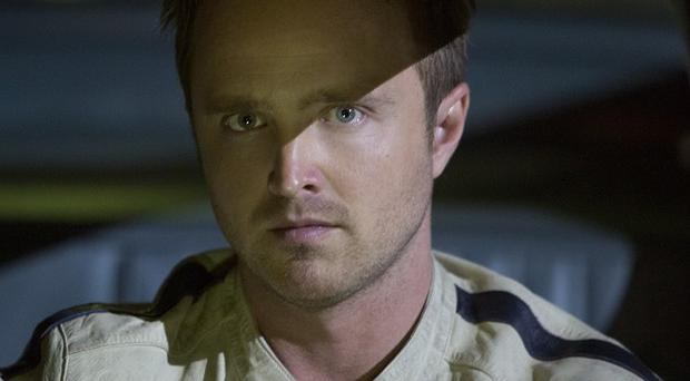 Aaron Paul got into the driving seat as Tobey Marshall in Need For Speed