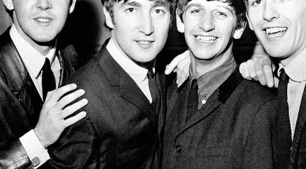 Jackets worn by George Harrison and Ringo Starr in the Beatles' film Help! have sold at auction