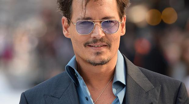 Johnny Depp almost confirmed his engagement while promoting his latest film in China