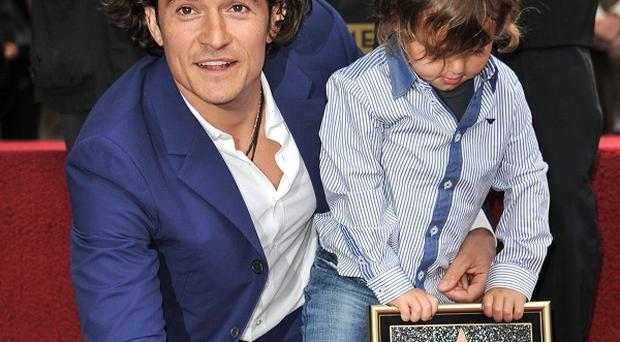 Orlando Bloom and son Flynn see his star on the Hollywood Walk Of Fame unveiled (AP)