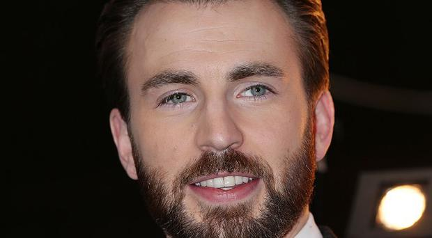 Chris Evans plays Captain America, who takes down S.H.I.E.L.D. in The Winter Soldier