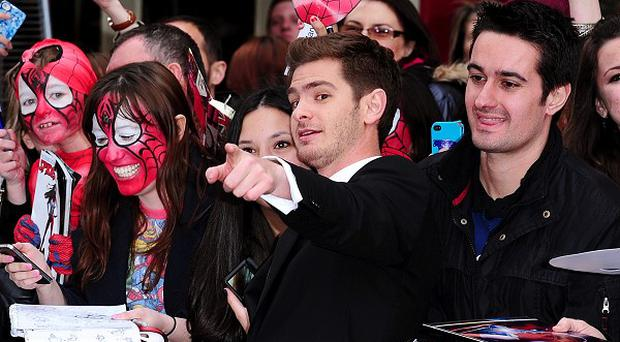 Andrew Garfield takes photographs with fans before the world premiere of the film The Amazing Spider-Man 2, held at the Odeon Leicester Square, central London.