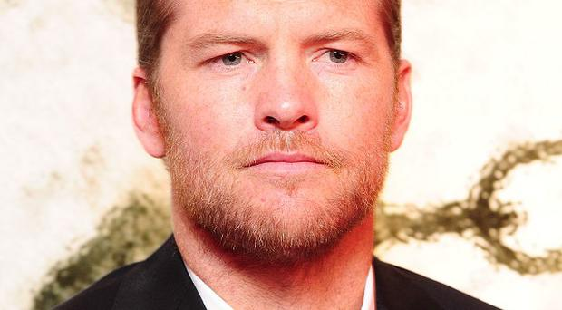 Sam Worthington was accused of punching a photographer