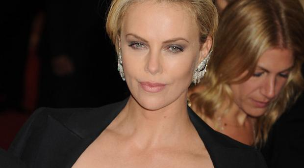 Charlize Theron would produce and star in the indie film American Express