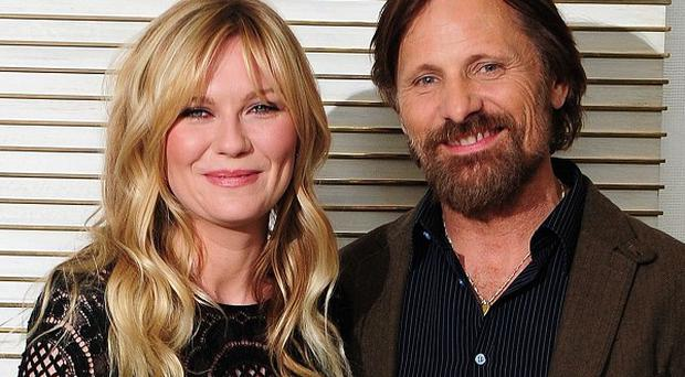 Kirsten Dunst and Viggo Mortensen attending a photocall for the film The Two Faces of January at the Corinthia Hotel in London before its UK premiere this evening.