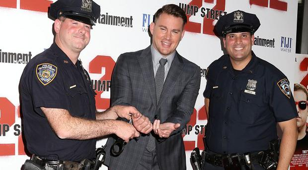 Channing Tatum posed with NYPD police officers at the New York premiere of 22 Jump Street