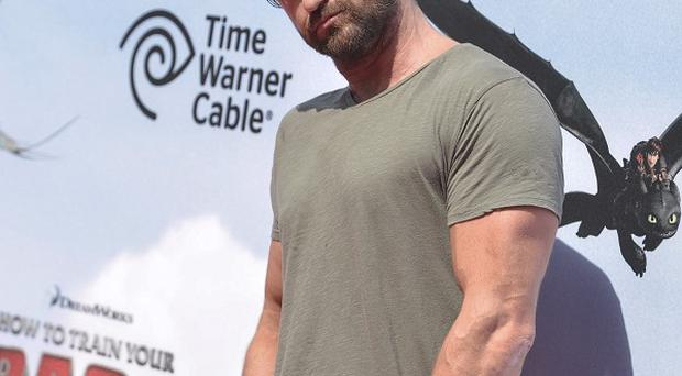 Gerard Butler stars in How To Train Your Dragon 2