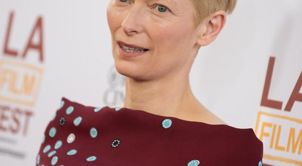 Tilda Swinton plays Minister Mason in Snowpiercer