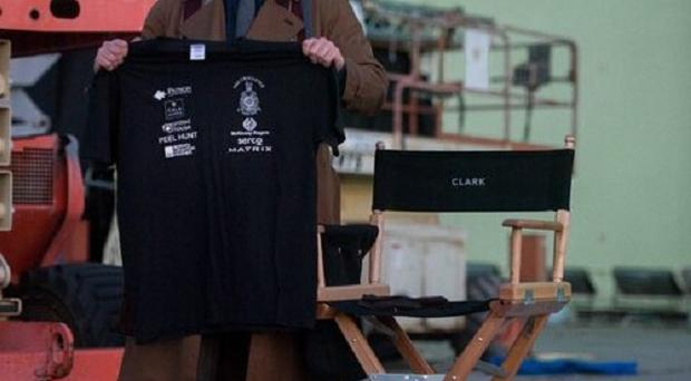 Henry Cavill posed in his Clark Kent costume for the Royal Marines Charitable Trust Fund