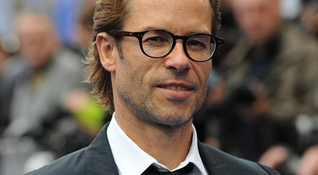 Guy Pearce wanted to read the script for Iron Man 3 before signing on