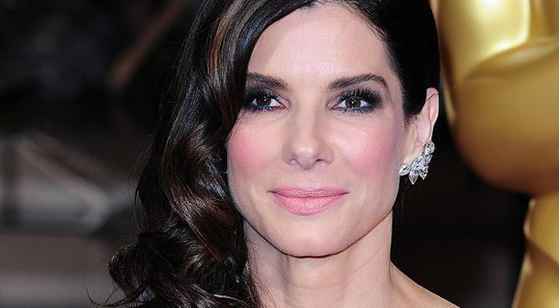 Sandra Bullock is tipped to play Tupperware's marketing executive Brownie Wise on the big screen