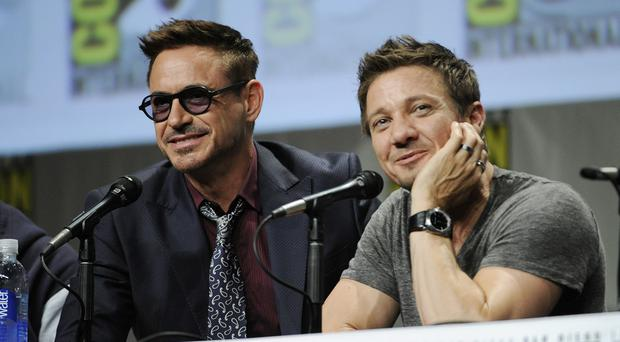 Actors Robert Downey and Jeremy Renner take part in the Marvel panel at Comic-Con International in San Diego (AP)