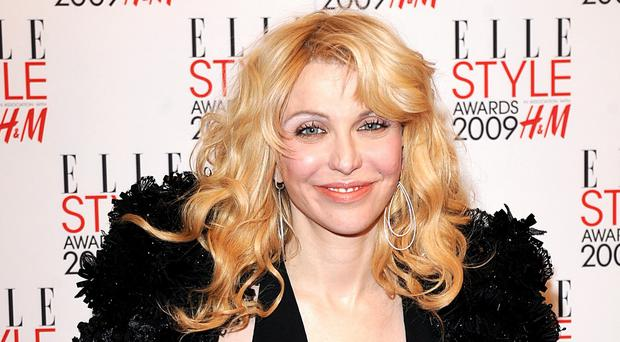 Courtney Love says she expects her Kurt Cobain biopic to start filming within a year