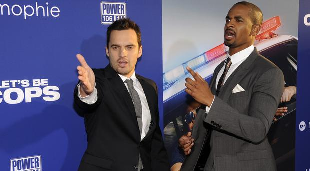 Jake Johnson and Damon Wayans Jr co-star in Let's Be Cops