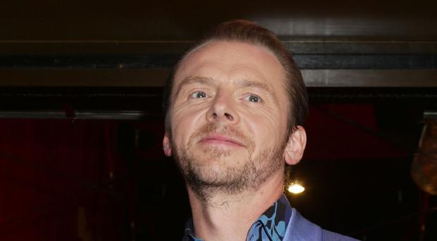 Simon Pegg arriving for the UK premiere of Hector And The Search For Happiness, at the Empire cinema in Leicester Square, London.