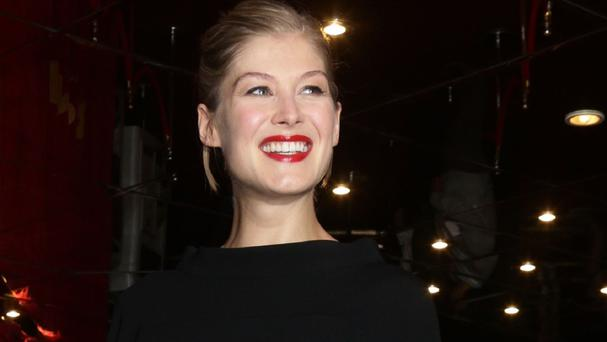 Rosamund Pike says she is excited about appearing in the adaptation of Gone Girl