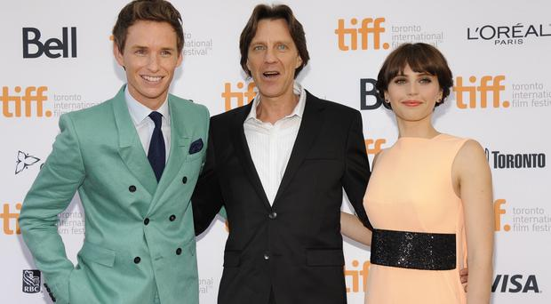 Eddie Redmayne with director James Marsh and co-star Felicity Jones at the premiere of The Theory Of Everything in Toronto