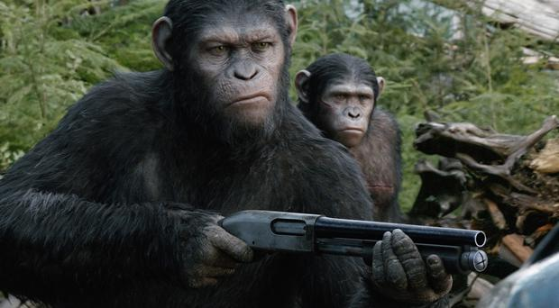 An ad for the film Dawn Of The Planet Of The Apes that showed an ape shooting a man dead with an automatic weapon has been cleared following 119 complaints