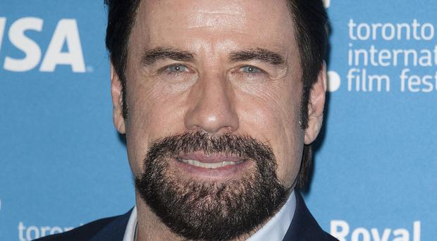 John Travolta tries to ignore media attention about his private life
