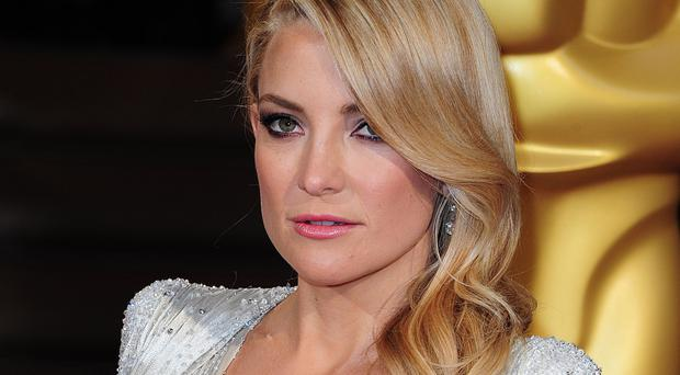 Kate Hudson says she tries to be honest as a parent