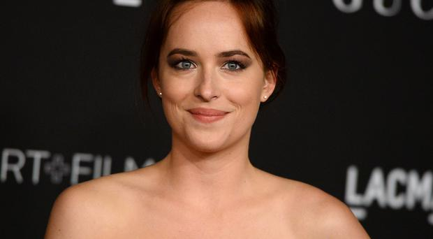 Dakota Johnson stars in the Fifty Shades Of Grey film