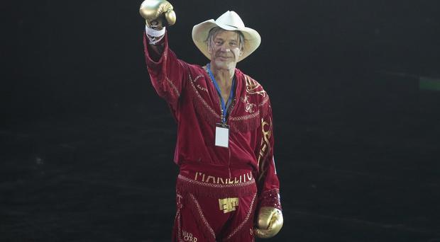 Mickey Rourke celebrates his victory at the Luzhniki Stadium, Moscow (AP)